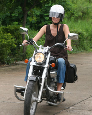 Tina learning to ride a bike in Chiang Mai